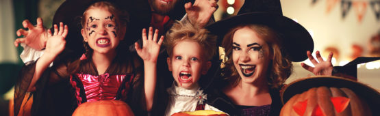happy family mother father and children in costumes and makeup on  Halloween
